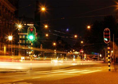 Amsterdam Lights Night life car goes through traffic light