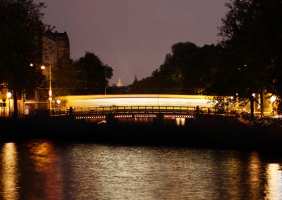 Amsterdam Lights Night Travel long exposure of tram over brigde