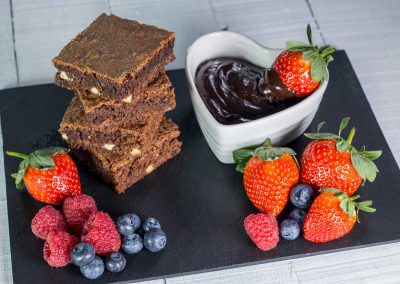 Food Photography of brownies and strawberries