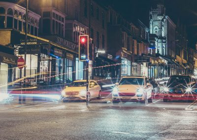 Cars lined up in a street in Harrogate at night